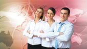 Three successful young business persons together — Stock Photo