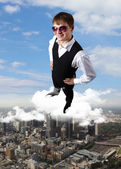 Young businessman against city background — Stock Photo