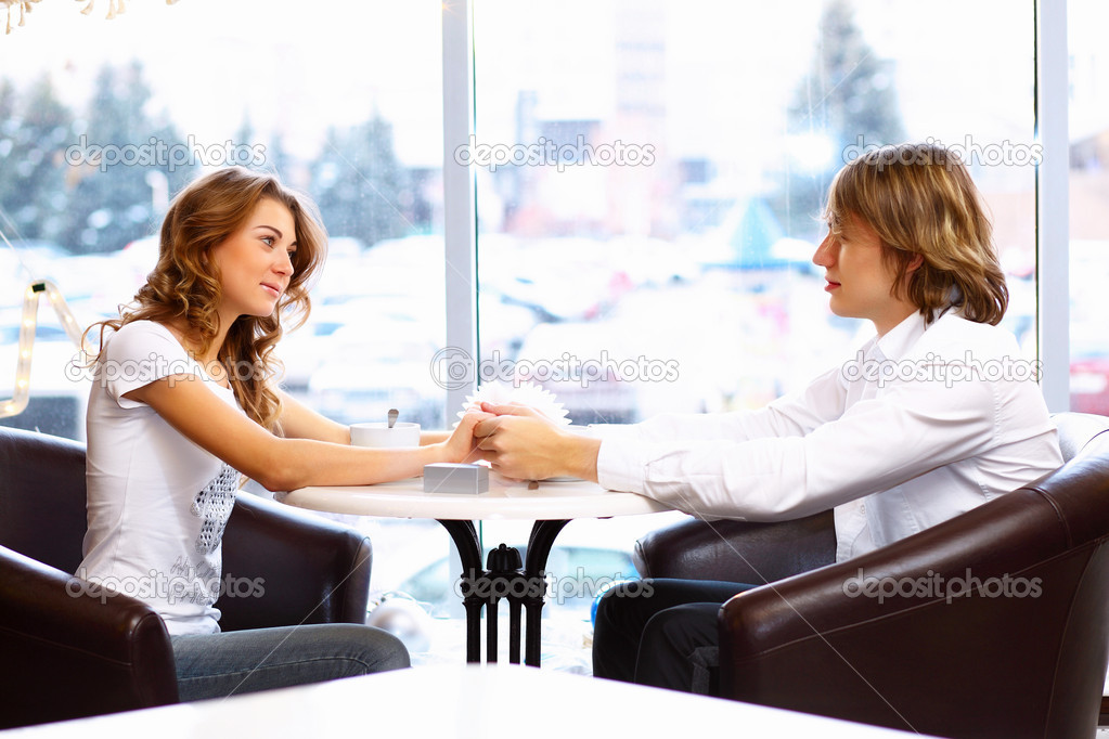 Young couple in love having a date in restaurant — Stock Photo #10830363