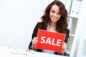 Young business woman with sale sign — Foto de Stock