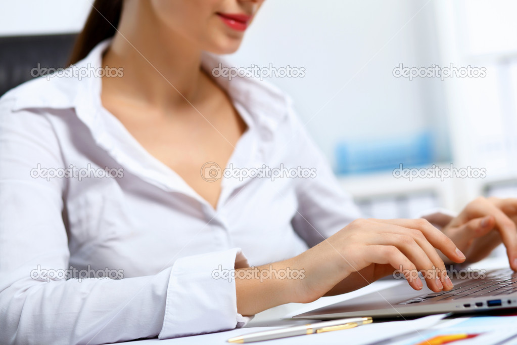 Young manager working with notebook in the office — Stock Photo #10959289