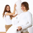 Young couple fighting with pillows — Stock Photo #11036143