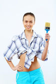 Woman with paint brushes — Stock Photo