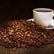 Coffee beans and white cup - Stock Photo