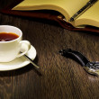 Black coffee and a book — Stock Photo #11167858