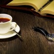 Stock Photo: Black coffee and a book