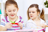 Little girl and study — Stock Photo