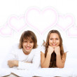 Young couple in white with heart symbols — Stock Photo