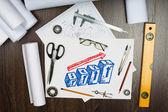 Ferramentas e papéis sobre a mesa — Foto Stock