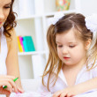 Little girl and her mother studying — Stock Photo #11196635