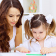 Little girl and her mother studying — Stock Photo #11196882