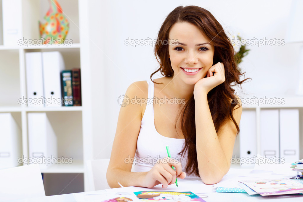 Student girl studying her lessons at home — Stock Photo #11196443
