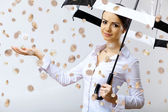 Business woman under money rain with umbrella — Photo