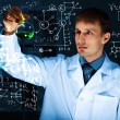 Young scientist in laboratory — Stock Photo #11273061