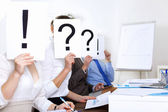 Businessmen in office with question marks — Foto de Stock