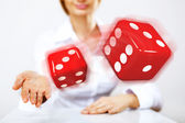 Flying dices as symbol of risk — Stock Photo