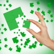 Puzzle pieces and human hand — Stock Photo