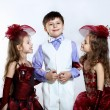 Stock Photo: Little girl in beautiful dress and boy