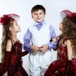 Little girl in beautiful dress and boy — Stockfoto