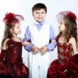 Little girl in beautiful dress and boy — Stock Photo #11348111