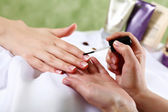 Female hands and manicure related objects — Stock Photo