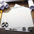 Tools and papers with sketches - Stock Photo