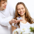 Young couple at home with present - Stock Photo