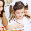 Stock Photo: Mother and daughter studying