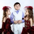 Little girl in beautiful dress and boy — Stock Photo #11357868