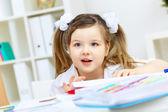 Little girl studying — Stock Photo