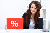 Young business woman with sale sign — Foto Stock