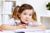 Little girl and her mother studying — Stock Photo