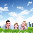 Stock Photo: Young happy family outdoor