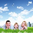 Young happy family outdoor — Stock Photo #11741530