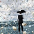 Royalty-Free Stock Photo: Money rain and businessman with umbrella