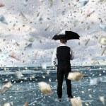 Money rain and businessman with umbrella — Stock Photo