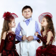 Little girl in beautiful dress and boy - Stok fotoğraf