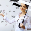 Business woman under money rain with umbrella — Stock Photo