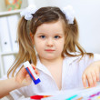Little girl studying - Stock Photo