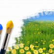 Paint brushes and landscape image — Stock Photo