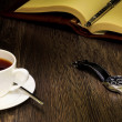 Black coffee and a book — Stock Photo