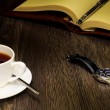 Black coffee and a book — Stock Photo #11798447