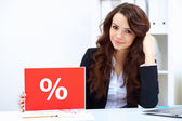 Young business woman with sale sign — Stock Photo
