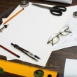 Stock Photo: Tools and papers with sketches