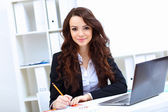 Young busines woman with notebook — Stock Photo