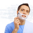 Young man shaving — Stock Photo