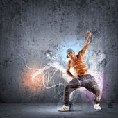 Young man dancing hip hop with color lines — Stok fotoğraf