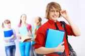 Student in red shirt with books — Stock Photo
