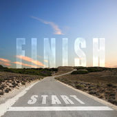 Road leading to finish — Stockfoto