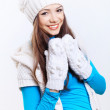Young woman wearing winter hat and warm scarf — Stock Photo #12291199